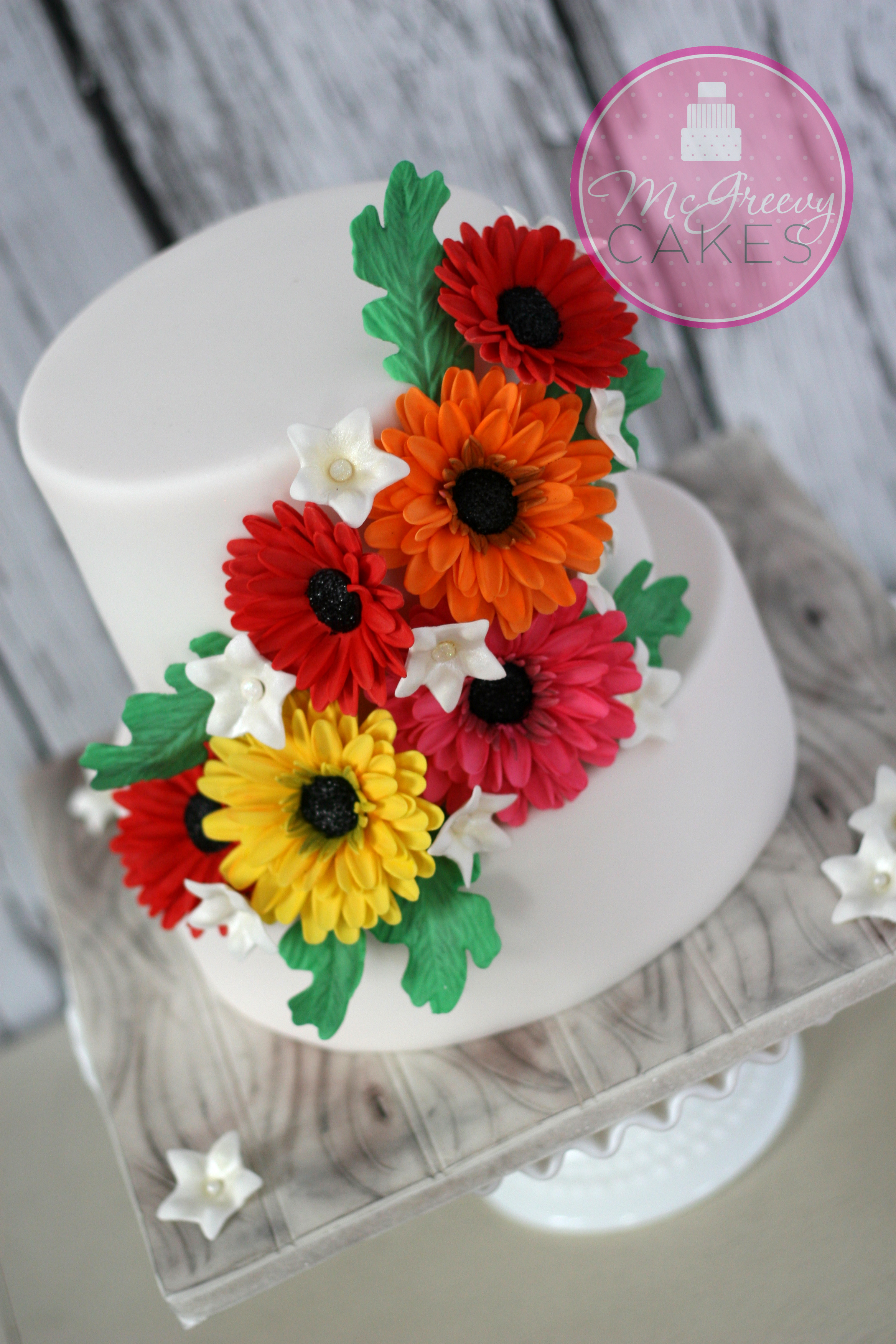 Cake Decorating How To Make Daisies : 70th Anniversary, Gerbera Daisy Cake - McGreevy Cakes