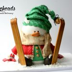 Skiing Snowman Cake & Free Edible Skiis Tutorial!